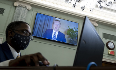 Facebook CEO Mark Zuckerberg appears on a screen as he speaks remotely during a hearing before the Senate Commerce Committee on Capitol Hill, Wednesday, Oct. 28, 2020, in Washington.