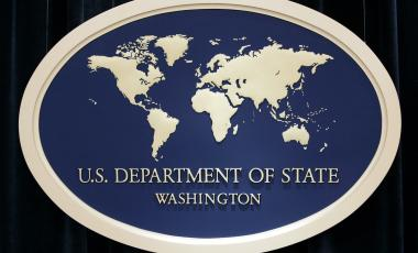 This Aug. 10, 2006, file photo shows the sign used as the backdrop for press briefings at the U.S. Department of State in Washington.