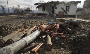 Unexploded ammunition scattered at a damaged ammunition store near Aeygestan, in outskirts of Stepanakert, the capital of the separatist region of Nagorno-Karabakh, Monday, Nov. 23, 2020.