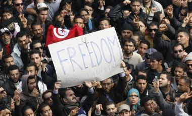 Protesters chant slogans against President Zine El Abidine Ben Ali in Tunis, Friday, Jan. 14, 2011.