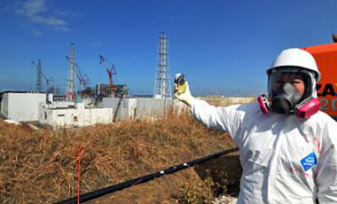 A journalist checks radiation levels near the Fukushima Daiichi nuclear power plant in 2012.
