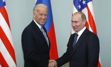 In this March 10, 2011, file photo, then-Vice President Joe Biden, left, shakes hands with Russian Prime Minister Vladimir Putin in Moscow, Russia.