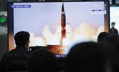 People watch a TV showing an image of North Korea's new guided missile during a news program at the Suseo Railway Station in Seoul, South Korea, Friday. March 26, 2021.