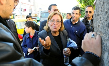 Kalthoum Kennou, a judge and former head of the country's judges' association, the first woman to take part in the presidential elections, campaigns in a street of Tunis, Wednesday, Nov.19, 2014.
