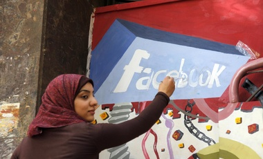 In this March 30, 2011, file photo. an art student from the University of Helwan paints the Facebook logo on a mural commemorating the revolution that overthrew Hosni Mubarak in the Zamalek neighborhood of Cairo, Egypt.