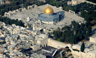 In this aerial photo from files dated Oct. 20, 2005, Muslim worshippers gather outside the Dome of the Rock Mosque, in the Al Aqsa Mosque compound, also known to Jews as the Temple Mount, and Jews gather at the Western Wall, bottom center, the holiest site where Jews can pray, in Jerusalem's Old City.