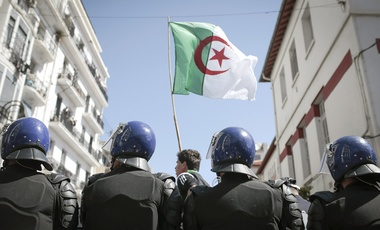 "Police stand guard as students demonstrate in Algiers, Algeria, Tuesday, April 9, 2019. Algerian protesters rejected the interim leader named Tuesday to replace former President Abdelaziz Bouteflika, shouting ""out with the system"" as they demonstrated for the dismantling of the political hierarchy that has led Algeria for two decades."