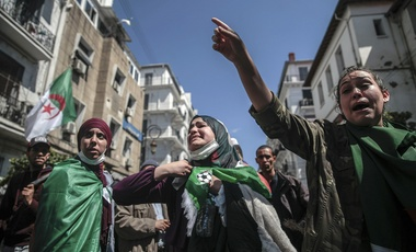 Women react after police attempted to disperse a demonstration for students in Algiers, Algeria, Tuesday, April 9, 2019. Algerian police used pepper spray and water cannons to break up a group of students protesting in the country's capital, less than an hour after the country's parliament chose an interim leader.