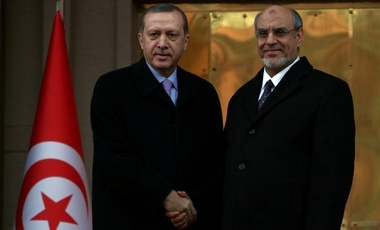 Turkish Prime Minister Recep Tayyip Erdogan, left, and his Tunisian counterpart Hamadi Jebali shake hands as they pose for cameras before a meeting in Ankara, Turkey, Tuesday, Dec. 25, 2012.