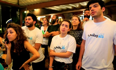In this Sunday, May 6, 2018 photo, supporters and volunteers of the coalition Kulna Watani or (We are all Patriots) gather at a Beirut shisha cafe as they watch television ahead of an expected announcement of elections results in Beirut, Lebanon.