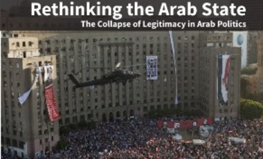 An Egyptian Army Helicopter flies over a crowd of pro-military demonstrators at Tahrir Square on July 26, 2013 in Cairo, Egypt.