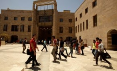 In this Monday, May 9, 2011 photo, students walk through the American University in Cairo campus in New Cairo, Egypt.