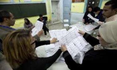 National observers and officials count votes at a polling station in Tunis, Tunisia.