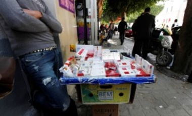 Issam Khedri, 29, eldest brother of cigarette vendor Adel Khedri, tends to the cigarette stand of his late brother in the Tunisian capital, Tunis. Adel set himself on fire outside the Municipal Theater in the heart of Tunis on March 12, 2013.