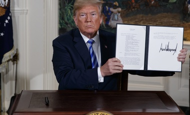 President Donald Trump shows a signed Presidential Memorandum after delivering a statement on the Iran nuclear deal from the Diplomatic Reception Room of the White House, Tuesday, May 8, 2018, in Washington, D.C.