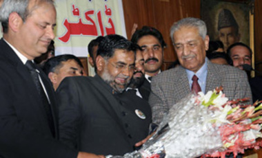 Pakistani lawyers present flowers to disgraced Pakistani nuclear scientist A. Q. Khan, right, upon his arrival to address an event in Rawalpindi, Pakistan, Jan. 9, 2010. Khan helped Pakistan develop nuclear weapons.