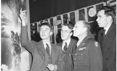 J. Robert Oppenheimer, Professor. H. D. Smyth, General Nichols, and Glenn Seaborg in 1946 looking at a photograph of the atomic blast at Nagasaki