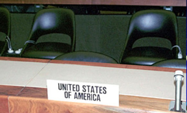 The seats of the U.S. delegation are vacant during the ceremony marking the entry into force of the Ottawa Convention on the prohibition of landmines at Geneva, Switzerland, on Mar. 1, 1999. The U.S. did not sign or ratify the convention.