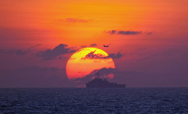 The amphibious transport dock ship USS Denver (LPD 9) transits the South China Sea at sunset to participate in exercise Cobra Gold 2010. Cobra Gold is an annual exercise designed to create interoperability between the Thai, U.S. and Singaporean task forces, 28 January 2010.