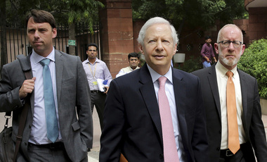 U.S. Ambassador to India Kenneth Juster, center, arrives with Assistant U.S. Trade Representative for South and Central Asia Christopher Wilson, right, and Brendan Lynch for a meeting with officials at the Indian Ministry for Trade and Industry at the parliament house in New Delhi, India, Friday, July 12, 2019.