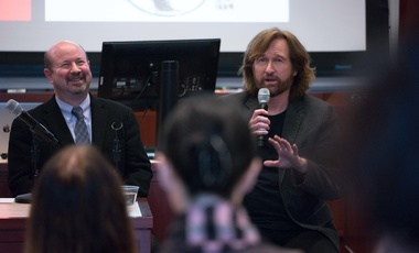Distinguished Professor of Atmospheric Science at Penn State Michael Mann and Pulitzer Prize-winning editorial cartoonist Tom Toles introduce themselves at the Starr Auditorium at Harvard Kennedy School on Wednesday, February 14, 2018. (Benn Craig)