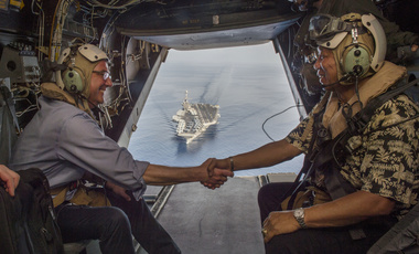 Secretary of Defense Ash Carter (left) and Philippine Secretary of National Defense Voltaire Gazmin (right) shake hands on a Marine Corps V-22 Osprey as they depart the USS Stennis after touring the aircraft carrier as it sails the South China Sea April 15, 2016.