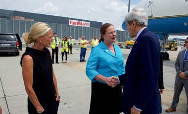 U.S. Secretary of State John Kerry shakes hands with the U.S. Representative to the Vienna Office of the United Nations and the International Atomic Energy Agency Ambassador Laura Holgate on July 22, 2016, after arriving at Vienna International Airport in Vienna, Austria, to attend a meeting aimed at amending the Montreal Protocol climate change agreement.