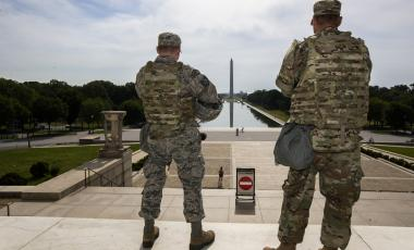 In this June 3, 2020 file photo members of the District of Columbia Army National Guard stand guard at the Lincoln Memorial in Washington securing the area as protests continue following the death of George Floyd, a who died after being restrained by Minneapolis police officers. An Ohio National Guardsman was removed from policing protests in Washington D.C. after the FBI found he expressed white supremacist ideology online, Gov. Mike DeWine announced in a briefing Friday, June 5, 2020.