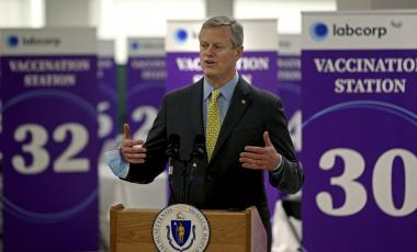 Massachusetts Governor Charlie Baker speaks at a mass vaccination site for coronavirus at the Natick Mall on Wednesday, Feb. 24, 2021 in Natick, Mass.