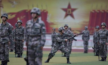 Photo of Chinese People's Liberation Army cadets taking part in a bayonet drills at the PLA's Armoured Forces Engineering Academy Base, in the outskirt of Beijing, China Tuesday, July 22, 2014.