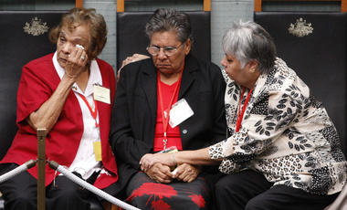 "A member of Australia's Stolen Generation wipes tears away as they listen to Australian Prime Minister Kevin Rudd deliver his speech where he apologized to its indigenous people for past treatment that ""inflicted profound grief, suffering and loss,"" in Canberra, Australia. February 13, 2008. (Mark Baker/Associated Press, Pool). Keywords: Australia, Stolen Generation, Aborigines, Kevin Rudd"