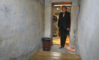 German Chancellor Angela Merkel enters a cell as she visits the prison of the former East German Ministry for State Security (MfS), known as the Stasi, in Berlin's Hohenschoenhausen district Tuesday May 5, 2009. (AP Photo/Fabrizio Bensch, Pool)