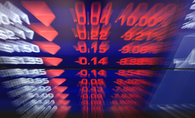 Display boards at the Australian Stock Exchange flash news of a falling market in Sydney, Friday, September 23, 2011.
