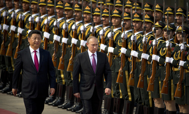 Chinese President Xi Jinping, left, and Russian President Vladimir Putin review an honor guard during a welcoming ceremony at the Great Hall of the People in Beijing, Saturday, June 25, 2016. (AP Photo/Mark Schiefelbein)