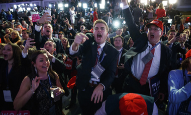 Supporters of then-candidate Donald Trump cheer as they watch election returns during an election night rally in New York on Nov. 8, 2016 (AP Photo/ Evan Vucci).