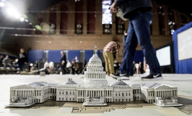 A model of the Capitol Building is displayed on a giant planning map during a media tour highlighting inaugural preparations Wednesday, Dec. 14, 2016, at the DC Armory in Washington. (AP Photo/Andrew Harnik)