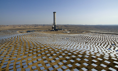 Mirrors (heliostats) circle a solar tower in the Negev desert, souther Israel