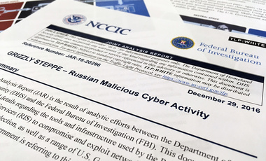The first page of the Joint Analysis Report narrative by the Department of Homeland Security and federal Bureau of Investigation and released on Dec. 29, 2016, is photographed in Washington, Jan. 6, 2017. Computer security specialists say the technical details in the narrative that the U.S. said would show whether computers had been infiltrated by Russian intelligence services were poorly done and potentially dangerous. (AP Photo/Jon Elswick)