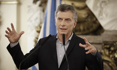 In this Feb. 16, 2017 file photo, Argentine President Mauricio Macri talks during a news conference at the government house in Buenos Aires, Argentina. Macri's government defended on Tuesday, Feb. 21, an accord between the government and a company lead by his father over a debt acquired when the company ran the Argentine postal service. (AP Photo/Victor R. Caivano, File)