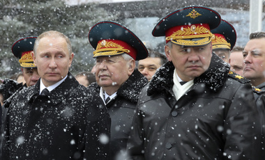 Russian President Vladimir Putin, left, and Defense Minister Sergei Shoigu, foreground right, attend a wreath-laying ceremony at the Tomb of the Unknown Soldier in Moscow, Russia, Thursday, Feb. 23, 2017. (Mikhail Klimentyev/Sputnik, Kremlin Pool Photo via AP)