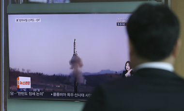 A man watches a TV news program reporting about North Korea's missile firing in Seoul, South Korea, on Thursday, April 6, 2017. (AP Photo/Lee Jin-man)