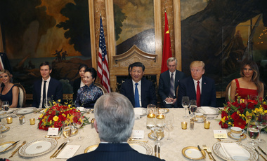 President Donald Trump and Chinese President Xi Jinping, with their wives, first lady Melania Trump and Chinese first lady Peng Liyuan are seated during a dinner at Mar-a-Lago, Thursday, April 6, 2017, in Palm Beach, Fla. Ivanka Trump, the daughter and assistant to President Donald Trump, and White House senior adviser Jared Kushner are seated at left. (AP Photo/Alex Brandon)