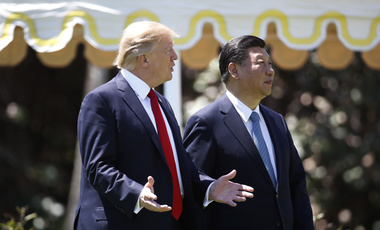 President Donald Trump and Chinese President Xi Jinping walk together at Mar-a-Lago on April 7, 2017. (AP Photo/Alex Brandon)