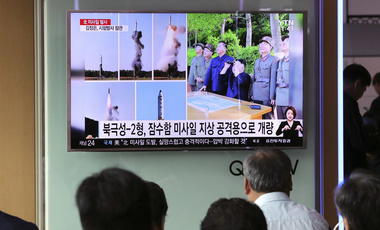 "People watch a TV news program showing images of North Korean leader Kim Jong Un and the missile launch, published in the North Korea's Rodong Sinmun newspaper, at Seoul Railway station in Seoul, South Korea, Monday, May 22, 2017. North Korea fired a solid-fuel ballistic missile Sunday that can be harder for outsiders to detect before launch and later said the test was hailed as perfect by leader Kim Jong Un. The letters on the top left reads ""North Korea, missile launch."" (AP Photo/Lee Jin-man)"