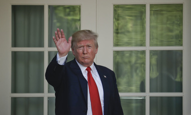 President Donald Trump waves as he returns to the Oval Office of the White House in Washington, Thursday, June 1, 2017, after speaking in the Rose Garden about the U.S. role in the Paris climate change accord. (AP Photo/Pablo Martinez Monsivais)