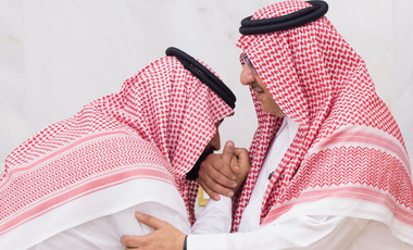In this Wednesday, June 21 , 2017 photo released by Al-Ekhbariya, Mohammed bin Salman, newly appointed as crown prince, left, kisses the hand of Prince Mohammed bin Nayef at royal palace in Mecca, Saudi Arabia. Saudi Arabia's King Salman on Wednesday appointed his 31-year-old son Mohammed bin Salman as crown prince, placing him first-in-line to the throne and removing the country's counterterrorism czar and a figure well-known to Washington from the line of succession. (Al-Ekhbariya via AP)