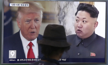 A man watches a television screen showing U.S. President Donald Trump, left, and North Korean leader Kim Jong Un during a news program at the Seoul Train Station in Seoul, South Korea on Aug. 10, 2017. (AP Photo/Ahn Young-joon, File)