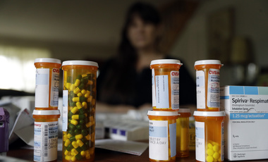 In this Aug. 10, 2017, photo, Sara Hayden poses with some of her medications at home in Half Moon Bay, Calif. Hayden lost her job as a data researcher because of medical problems and is now covered by Medi-Cal, as Medicaid is called in California (AP Photo/Marcio Jose Sanchez).