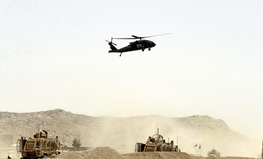 "In this August 2, 2017 file photo, A US military helicopter flies over the site of a suicide bomb that struck a NATO convoy in Kandahar south of Kabul, Afghanistan. In an ""open letter"" to U.S. President Donald Trump, Afghanistan's Taliban on Tuesday reiterated their call for a withdrawal of troops to end the protracted war. (AP Photo)"