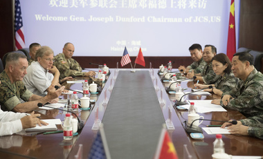 U.S. Chairman of the Joint Chiefs of Staff Gen. Joseph Dunford, left, and Chinese Northern Theater Command Commander Gen. Song Puxuan, right, meet together at Northern Theater Command Army Force Haichung Camp in Haichung, China on Wednesday, Aug. 16, 2017. (AP Photo/Andrew Harnik)